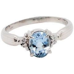 Aquamarine Oval and White Diamond Round Ring in Platinum