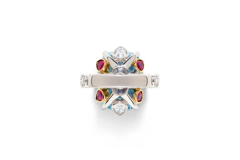 Blossom Collection, Aquamarine, Rubelite and Diamond Ring. The Blossom Collection coloured gemstones are a uniquely designed cut of an oval cushion cut top with a high crown to emulate an antique Georgian style with a brilliant cut base to maximise