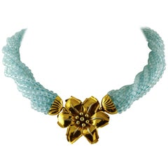 Aquamarine Torchon with 18 Karat Yellow Gold and Diamonds Flower Closure