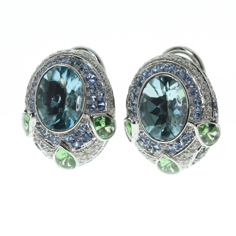 Aquamarine Tsavorite Diamonds Sapphire 18 Karat White Gold Oriental Eairrngs   Aquamarine have bufftop Oval cut, the crown is cabochon and pavilion is faceted. This cut looks very vibrant with the Aquamarine, Tsavorites are supported the color