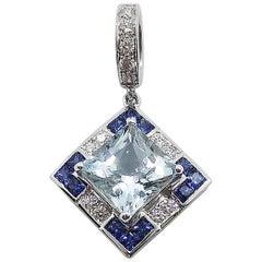 Aquamarine with Blue Sapphire and Diamond Pendant Set in 18 Karat White Gold
