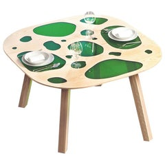 Aquário table in green glass and wood by the Campana brothers