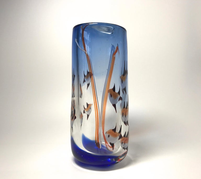 'Aquarium' tall heavyweight glass vase from Murano, Italy, created in the 1960s Cobalt blue glass infused with fish, bubbles and reeds, a fun piece, circa 1960 Measures: Height 8.5 inch, diameter 3.5 inch In very good condition. Minor graze to