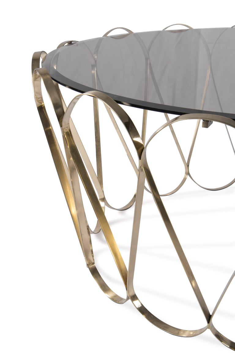 Aquarius is a unique center table. An evocative of a fine jewelry piece, this striking table blends a certain delicacy with its contrasting strong character. Perfect for your contemporary living room, Aquarius will add a touch of elegance to your
