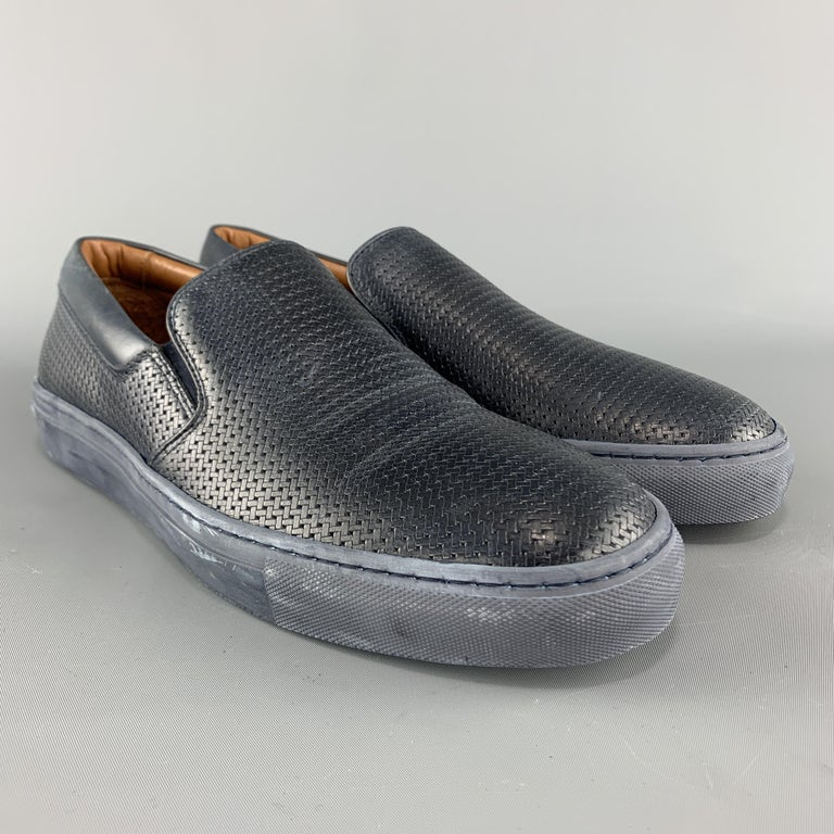 AQUATALIA slip on sneakers come in navy woven leather with a tonal rubber sole. Wear throughout. Made in Italy.  Good Pre-Owned Condition. Marked: US 10  Outsole: 11.75 x 4 in.