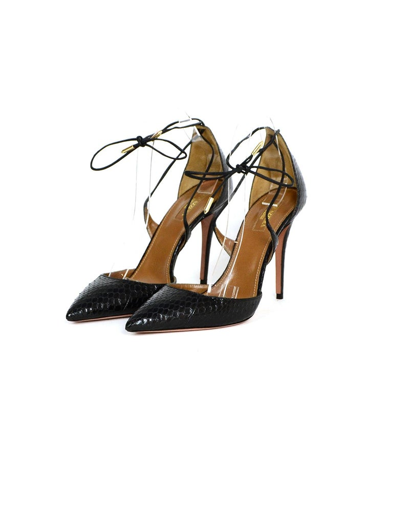 Aquazzura Black Python Lace Up Pumps sz 39.5  Made In: Italy Color: Black Hardware: Goldtone Materials: Python Closure/Opening: Laces Overall Condition: Excellent pre-owned condition, very minor wear to insoles  Marked Size: 39.5  Heel Height: 4