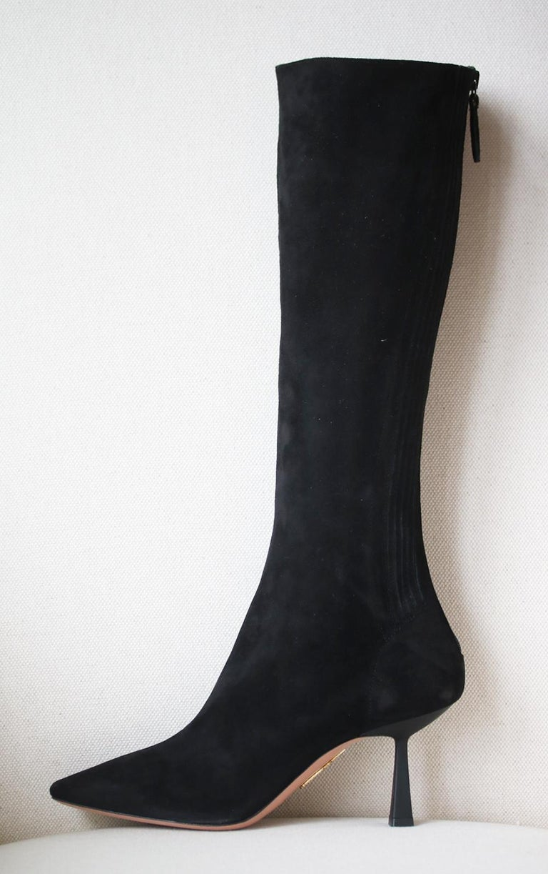 Aquazzura's 'Curzon' boots are made from black suede and have distinctive 75mm heels. They're a great year-round option and fit closely around the calves thanks to the discreet zips and subtle elasticated paneling.  Heel measures approximately 75mm/