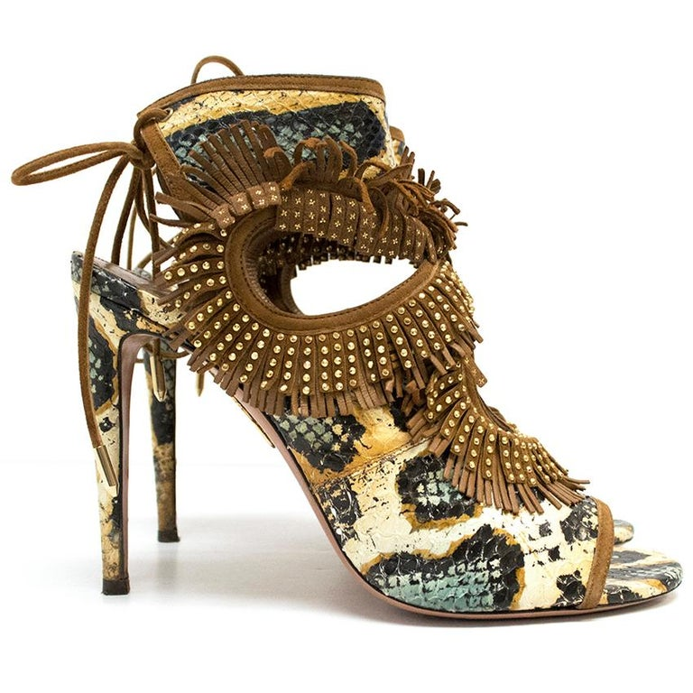 Aquazzura snake skin multicoloured fringe peep toe heels with gold detail.  This item is in good condition with a tan leather fringe and lace detail. These shoes has minor wear to the sole and heel.  Condition: 9/10  Approx: Heel Height 11cm  Width