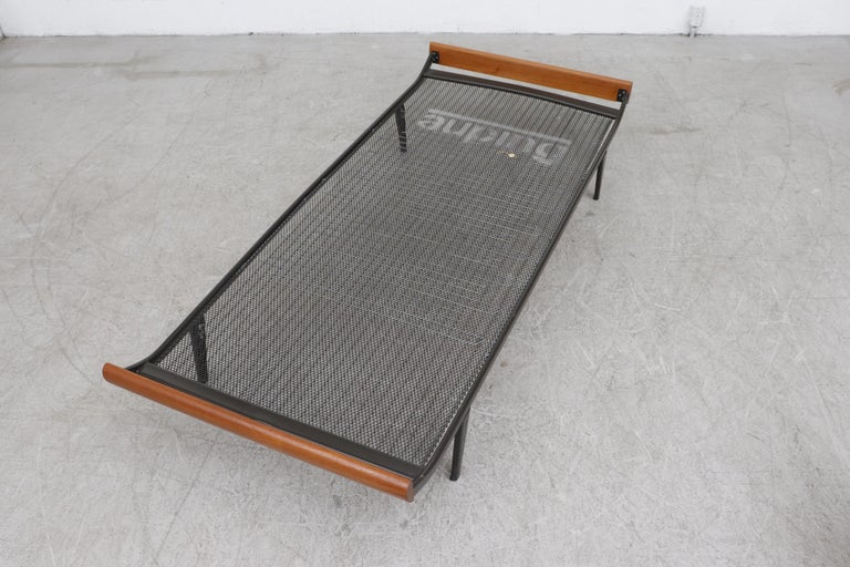 1960s Cleopatra daybed by A.R. Cordemeyer. With new indigo upholstered mattress, matching bolster, teak ends and dark brown enameled metal frame with