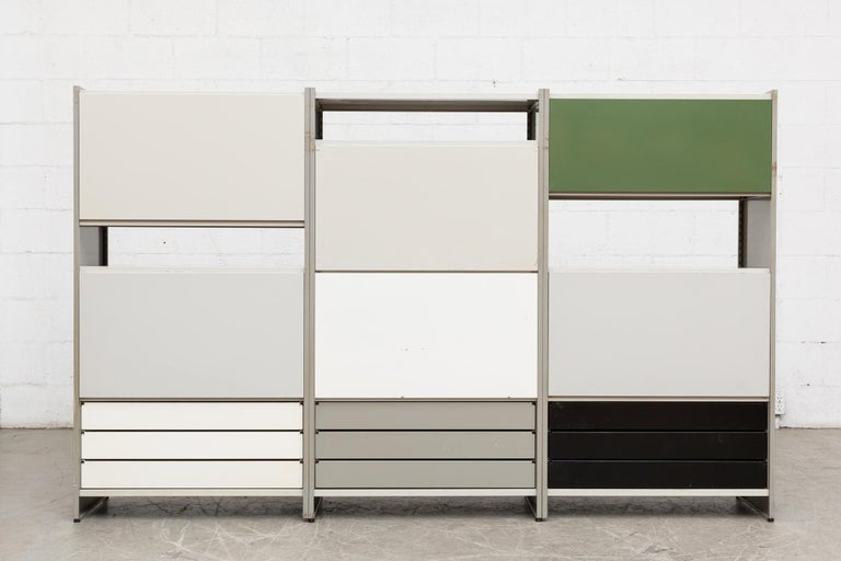 Large Gispen 5600 industrial shelving unit by A.R. Cordemeyer. Grey enameled metal three-section industrial bookshelf and storage unit with drop down desk and double purple metal drawers, a green back panel; two cabinets with enameled metal sliding