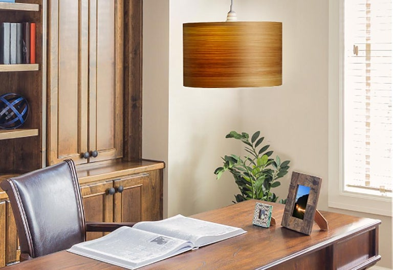 This large cypress wood drum light, ARA, is a Mid-Century Modern style pendant. Designers use a chandelier for alcove, entryway, dining room or conference room. ARA is a customizable shade offered in several wood types. ARA gives a warm light,