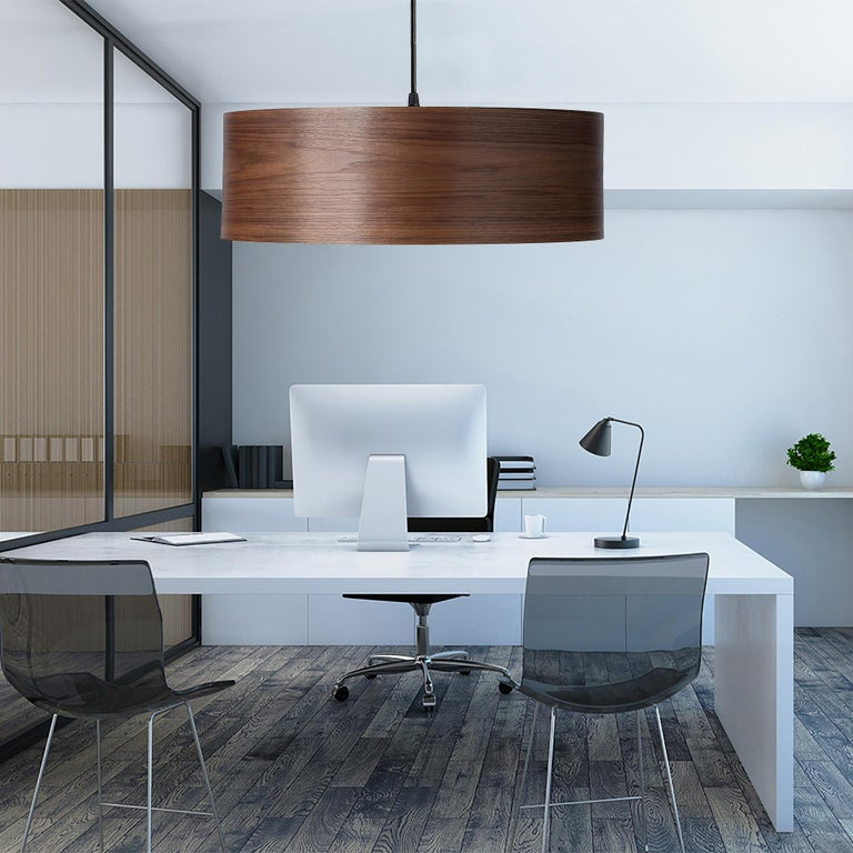 This large walnut wood drum light, ARA Grande, is a Mid-Century Modern style pendant. As a chandelier for alcove, entryway, dining room or conference room, ARA Grande is offered in several customized wood types. ARA Grande gives a warm light,