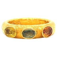 ARA985 Hand Made Sapphire Three Stone 24 Karat Yellow Gold Textured Ring