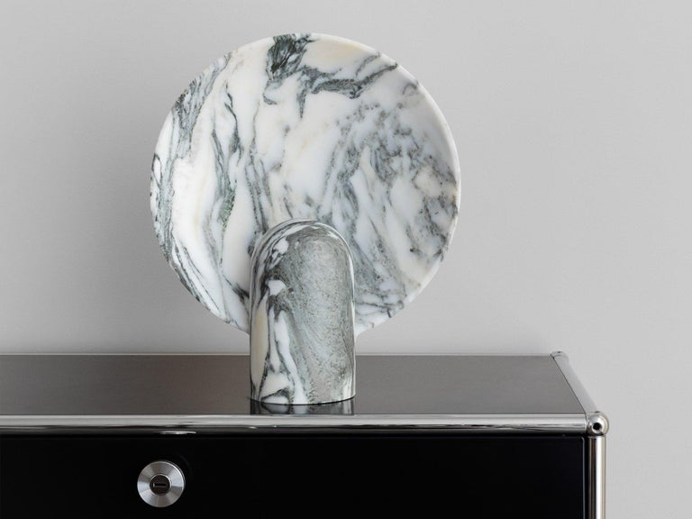 Arabescato Marble lamp by Henry Wilson Dimensions: Surface sconce are 35 x 30 x 10 cm Materials: Arabescato marble  Ambient, sculptural light carved in two halves from solid stone. Each light is manufactured in natural stone, meaning variations of