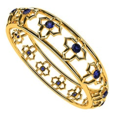 Arabesque 18 Karat Yellow Gold and Sapphire Bangle