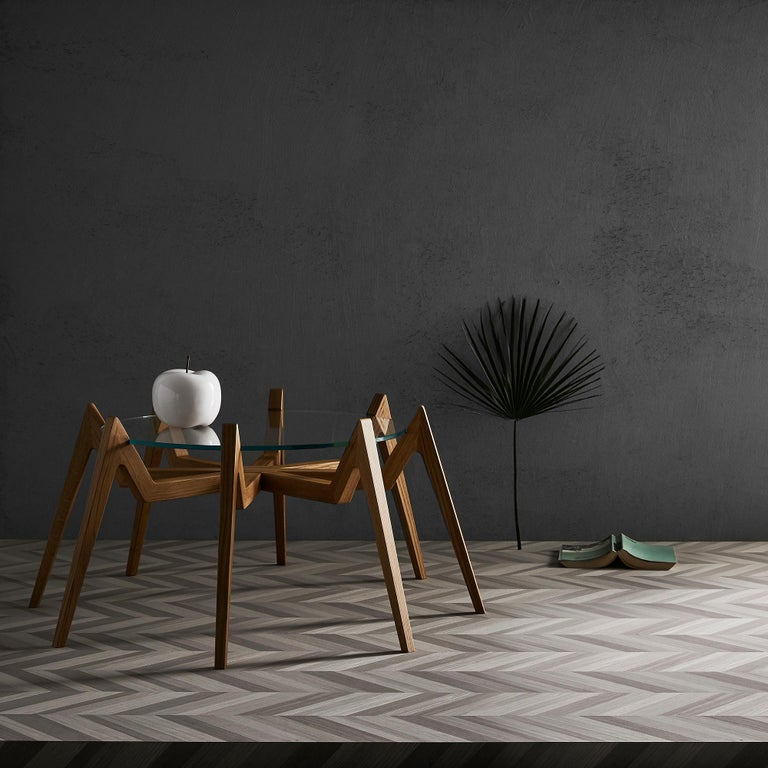 Aracne is a coffee table that combines the charm of design with the novelty of unexpected structure. In fact, the underlying idea of the Aracne coffee table is to make everything lighter by increasing the number of anchor points: the eight legs of