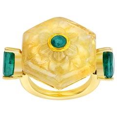 Araya 26.30 Carat Carved Yellow Sapphire and Zambian Emerald Ring