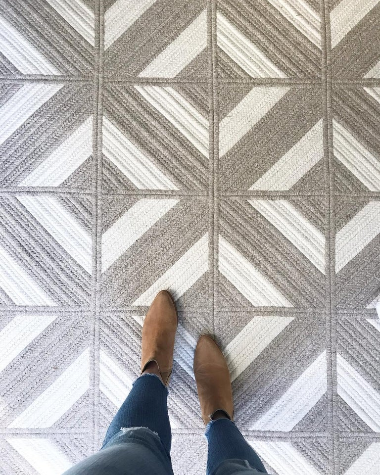 The Araz Woven Wool Rug combines geometric textural flat and cable woven braid of light grey and cream yarns in natural un-dyed wool. Designed in the Thayer Design Boston Studio and custom made to order in Rhode Island, USA, each piece is crafted