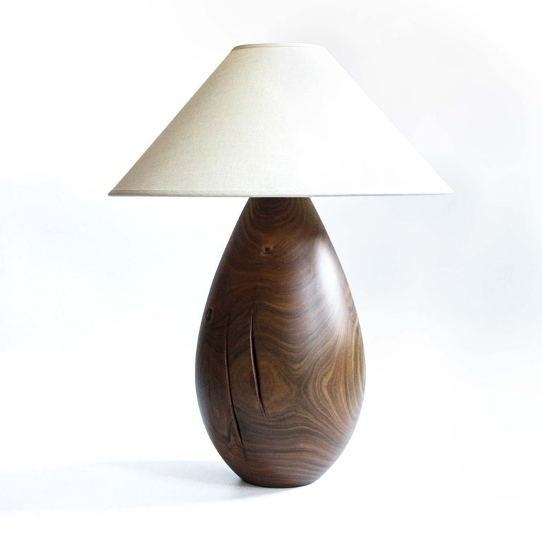 The Árbol collection is an embrace of tropical modernism; each lamp is composed of salvaged tropical hardwoods from the Bolivian city of Santa Cruz, where trees that are felled by natural causes—or for construction—are rescued by our team. A blend