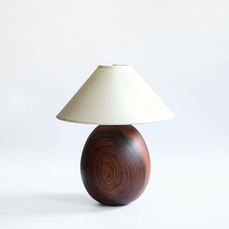 The Árbol collection is an embrace of tropical modernism, each lamp is composed of salvaged tropical hardwoods from the Bolivian city of Santa Cruz, where trees that are felled by natural causes—or for construction—are rescued by our team. A blend