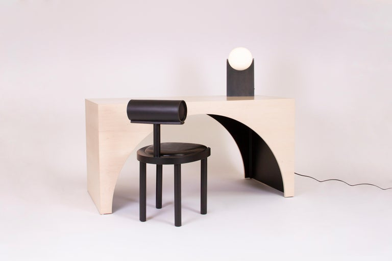 Arc desk made from wood with a bleached maple veneer finish and black stained interior.  Can also be used as a small dining table or wide console.  Designed and handmade in Los Angeles by Estudio Persona.