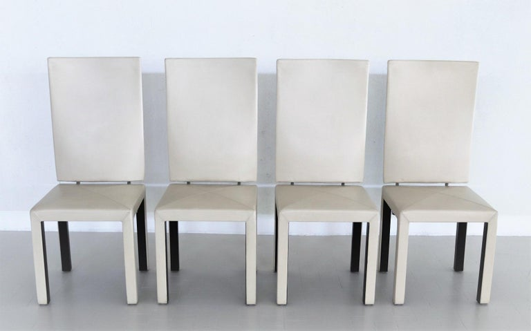 Set of four dining chairs by designer Paolo Piva, manufactured by B&B Italia in Italy in the 1980s. The chairs have a high back, which is connected to the seat with a special metal construction. This construction allows a slight swing. The chairs