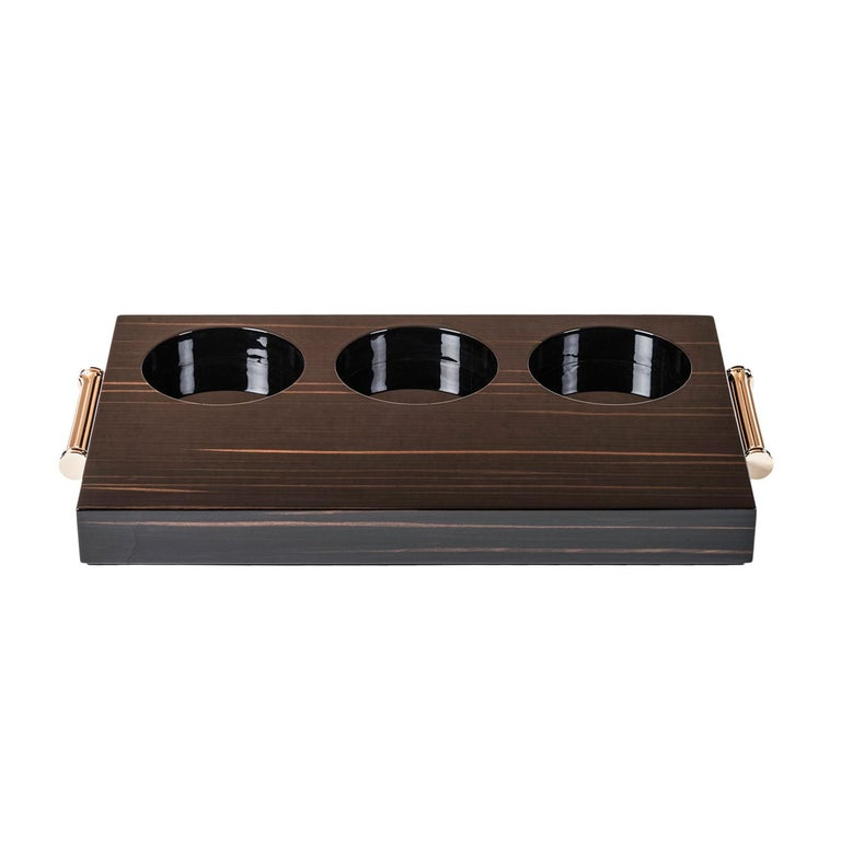 Tray in Macassar ebony veneer with gloss finish. 24-karat gold plated brass handles.