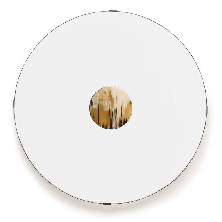 Round wall mirror with 20 cm diameter horn detail. Frame in chromed brass.  Overall Dimensions: W 90 x H 90 cm.