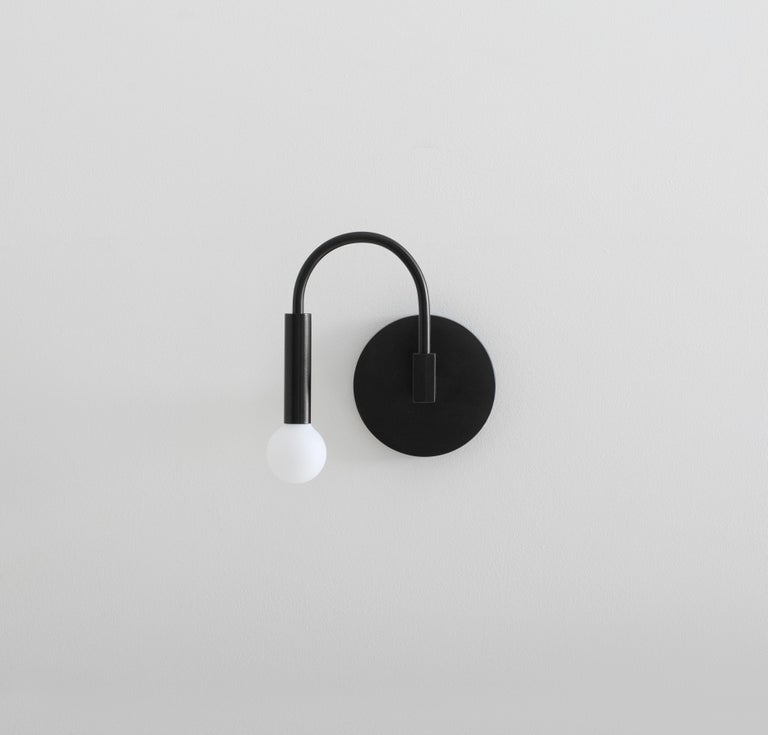 Minimalist Arch, a Contemporary Wall Sconce in Matte Black with Satin Glass Globe, ADA For Sale