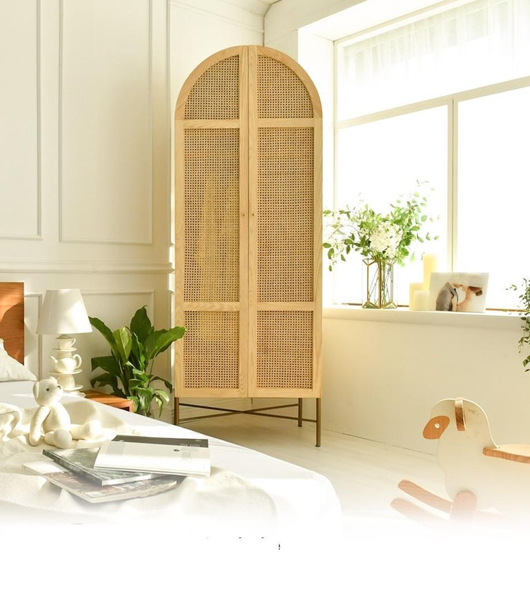 Oak and woven rattan panelled wardrobe/dresser cabinet crafted by artisans with 100% natural woven cane and solid oak frame. The Arch cabinet will add a boho vibe and colonial luxe feel to any bedroom.