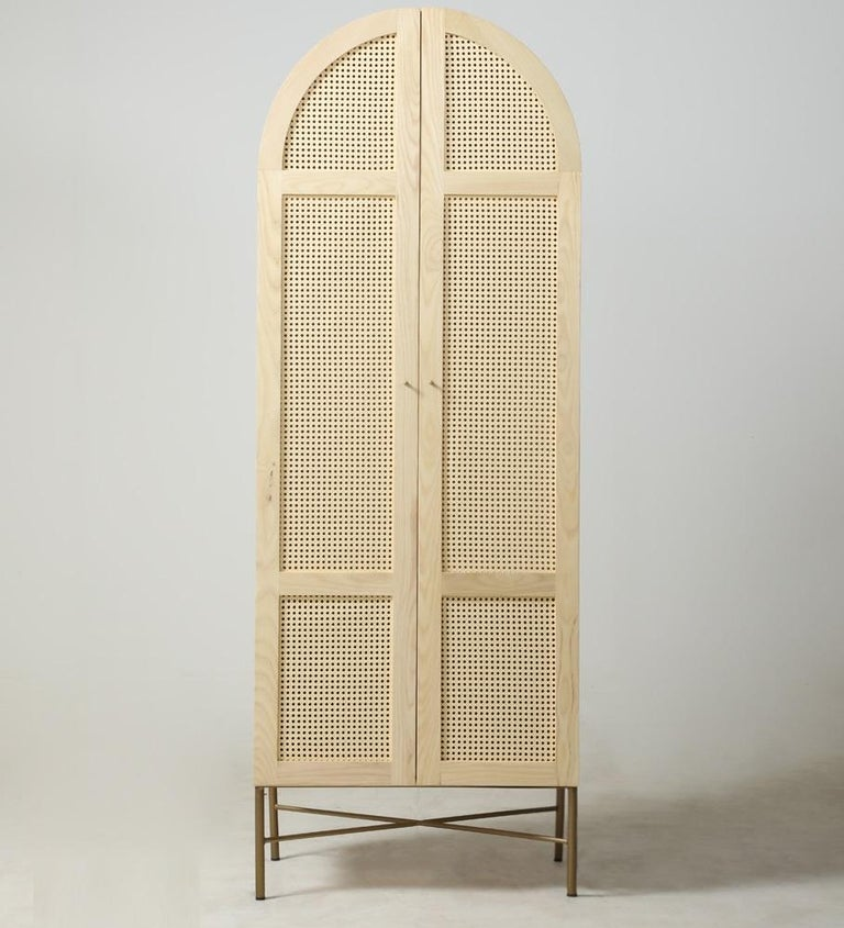 Mid-Century Modern Arch Cane Cabinet Featuring Antique Brass Legs For Sale