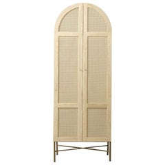 Arch Cane Cabinet Featuring Antique Brass Legs