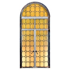 Arched Iron Framed French Window with Yellow Glass