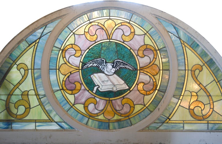 American Arched Stained Glass with Painted Dove and Bible For Sale