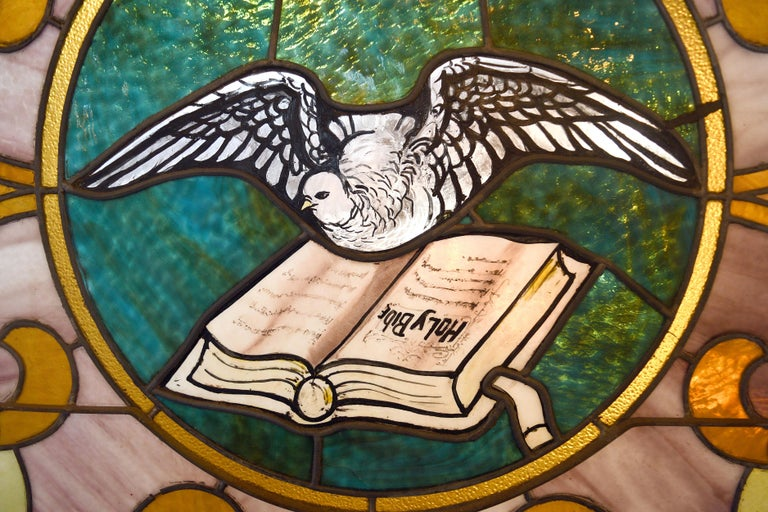 Arched Stained Glass with Painted Dove and Bible In Good Condition For Sale In Minneapolis, MN