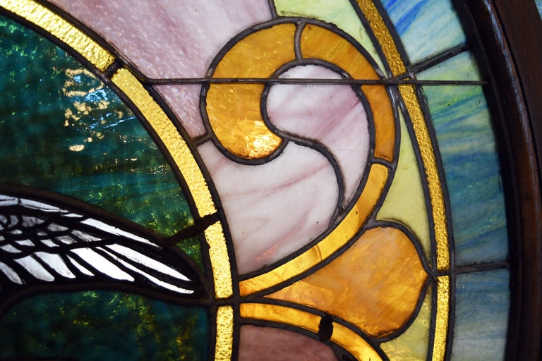 Early 20th Century Arched Stained Glass with Painted Dove and Bible For Sale