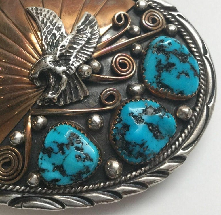 Native American Navajo Sterling silver and gold turquoise belt buckle by Archie Martinez.  Marked: STERLING, 1/20 12K GF.  Signed: A. Mtz.  Measures: 3 1/4