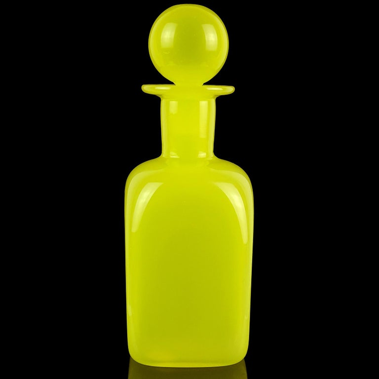 Beautiful Murano hand blown bright yellow Italian art glass decanter / bottle, with original stopper. Documented to designer Archimede Seguso. It has 2 original labels still attached, including