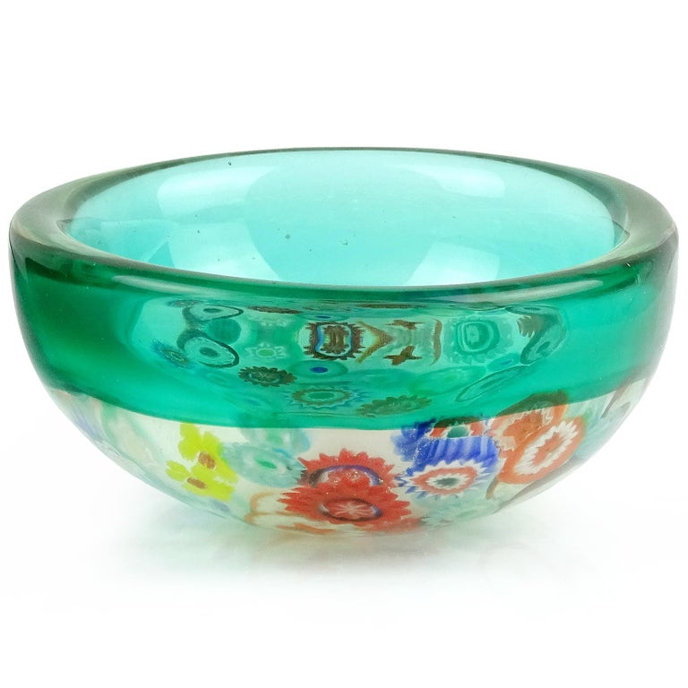 Beautiful Murano handblown Millefiori flower canes and green Incalmo rim Italian art glass round bowl. Documented to designer Archimede Seguso. The murine pieces are all different colors and designs. Measures 5 1/4