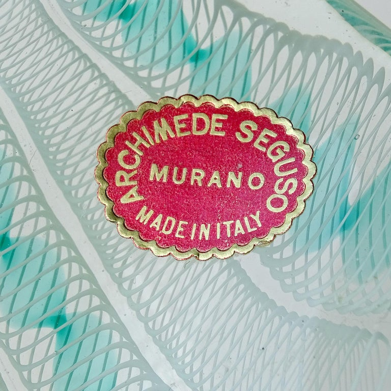 Beautiful Murano hand blown Zanfirico ribbons Italian art glass bowl. Documented to designer Archimede Seguso, circa 1955. Still retains an original