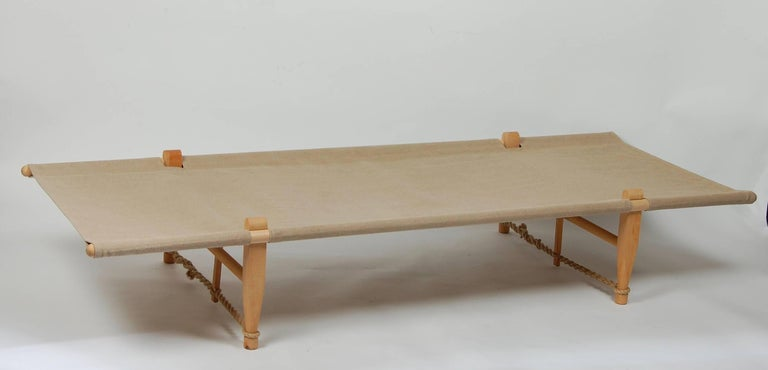 Canvas and birch cot or daybed by architect Ole Gjerlov Knudse, originally designed for his son for their camping trips in 1962, this example is most likely a later production. High grade canvas, birch frame and hemp rope. Breaks down and assembles