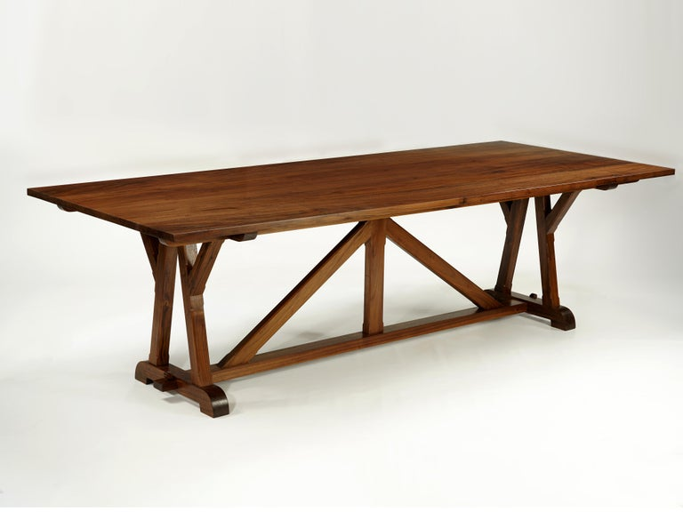 This classic design recalls timbered roof trusses used for centuries in European churches and elsewhere. Exposed beams are connected using traditional mortise and Tenon joints, forming variations of triangles that give the rigidity necessary to