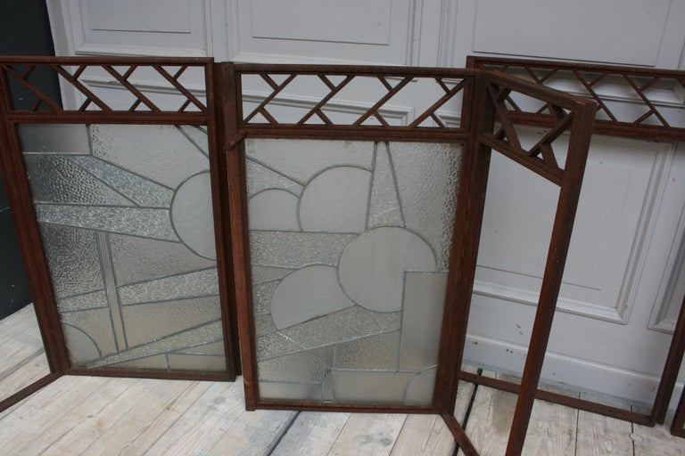 Exceptional set of 4 Art Deco windows. The 2 large windows from the set with swiveling side element also have the original Art Deco stained glass.