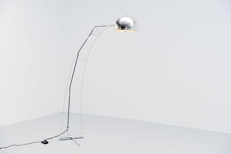 Extraordinary architectural arc floor lamp made by unknown designer and manufacturer but produced in Italy, 1970. The lamp has a very nice constructed frame and an aluminium shade. The frame is chrome plated and is hold into balance because of the