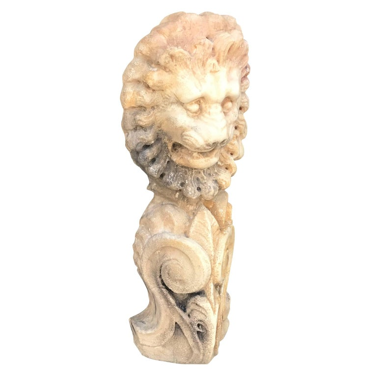 An architectural lion head made of hand carved Carrara marble. Wear consistent with age and use. Circa 1700, from a renaissance estate in Padua, Italy.