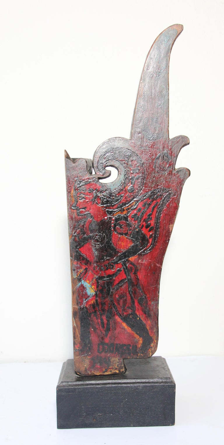 Antique architectural carved wood temple truss fragment from Rajasthan India. Large and heavy wood hand carved fragment architectural temple fragment mounted on a wooden base. Hand-painted Indian God figure with foliages and flower, painted in