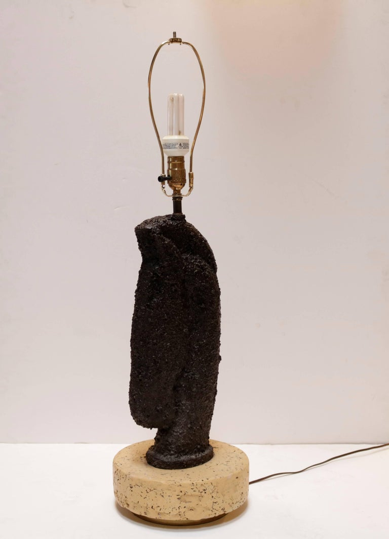 This unique pair of horse head lamps are rendered in bubbly black resin. They are mounted on thick cork platforms with inset brass bases. The new custom-made lampshades are a light beige linen matching the bases.