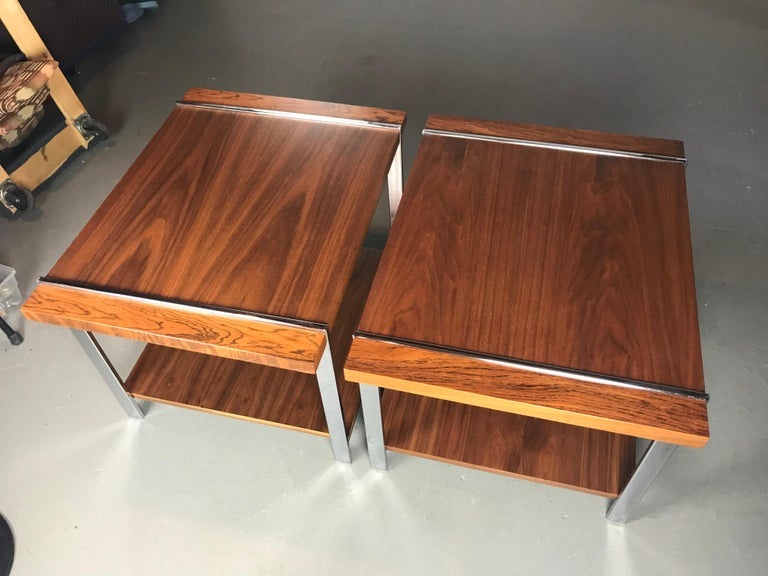 Very nice pair of Mid-Century Modern end tables by Lane. Made of rosewood, walnut & chrome. The tables have been refinished. Very light signs of use on the chrome. Nice chrome frames that show the wood planks jutting through.   28 x 22 x 20