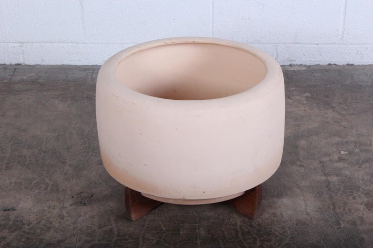 An early bisque tire planter with original redwood base by Rex Goode and John Follis for Architectural Pottery. Unsigned.