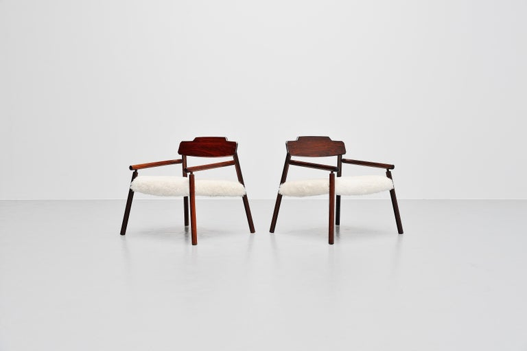 Absolutely stunning pair of lounge chairs made by unknown architect from Italy, 1950. These chairs have hexagonal shaped solid rosewood legs and fantastic shaped back rests in solid rosewood. Unfortunately after researching we cannot find the